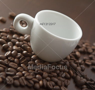 White Cup On The Coffee Beans Background Stock Photo