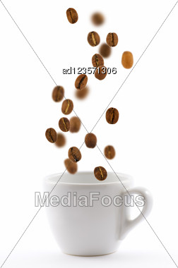 White Cup With Coffe Beans Isolated Stock Photo