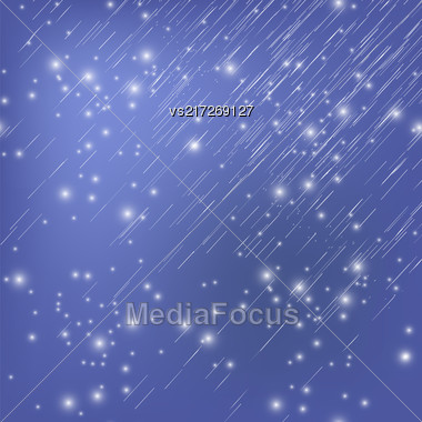 White Falling Star On Blue Night Sky Background. Shooting Stars On Nignt Sky. Meteor Shower Stock Photo