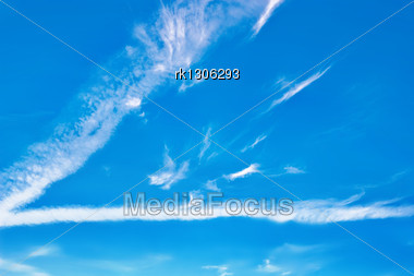 White Light Cirrus Clouds Against The Blue Sky Stock Photo