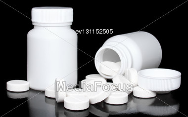 White Medicine Bottle, Color Pills On Black Background Stock Photo