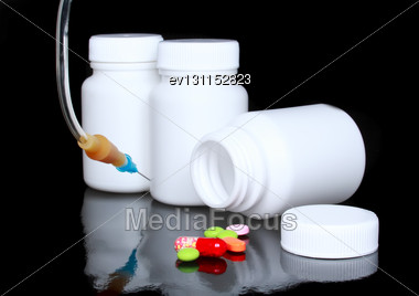 White Medicine Bottle, Infusion Set Colour Pills On Black Background Stock Photo