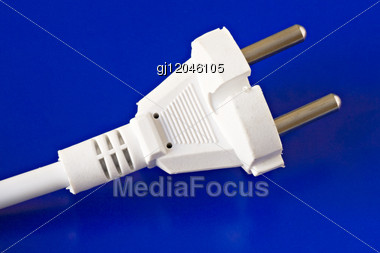 White Power Plug Isolated On Blue Background Stock Photo