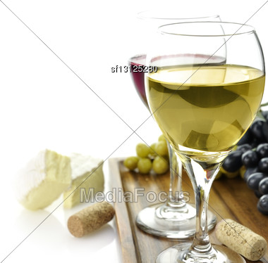 White And Red Wine Glasses With Cheese And Grape Stock Photo