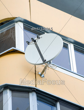 White Sat TV Dish On A Balcony Stock Photo