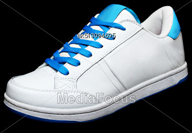 White Sport Shoe Isolated On Black Background Stock Photo
