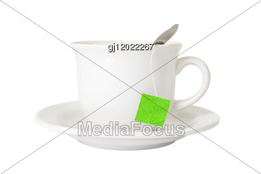 White Tea Cup With Green Leaf Label Stock Photo
