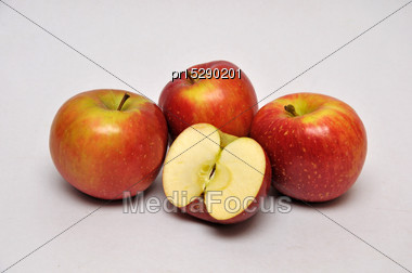 Whole And Sliced Apples On A Seamless Background Stock Photo