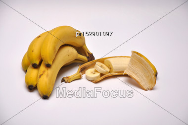 Whole And Sliced Bananas On A Seamless Background Stock Photo