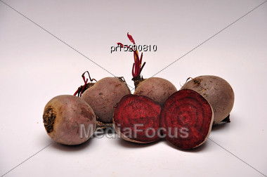 Whole And Sliced Beetroots On A Seamless Background Stock Photo