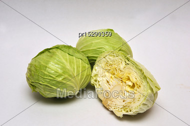 Whole And Sliced Cabbages On A Seamless Background Stock Photo