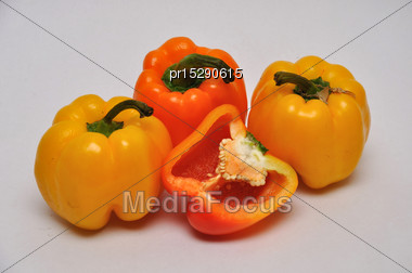 Whole And Sliced Capsicums On A Seamless Background Stock Photo