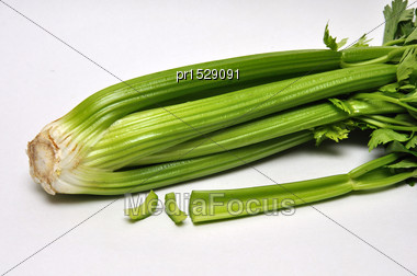 Whole And Sliced Celery Stalks On A Seamless Background Stock Photo