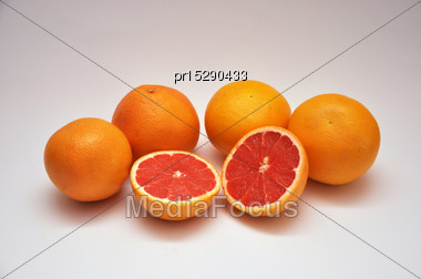 Whole And Sliced Grapefruit On A Seamless Background Stock Photo