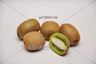 Whole And Sliced Kiwifruit On A Seamless Background Stock Photo