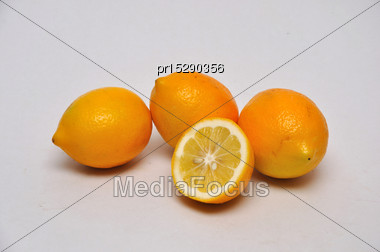 Whole And Sliced Lemons On A Seamless Background Stock Photo
