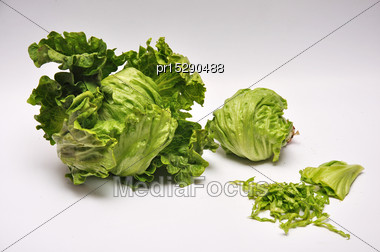 Whole And Sliced Lettuce On A Seamless Background Stock Photo