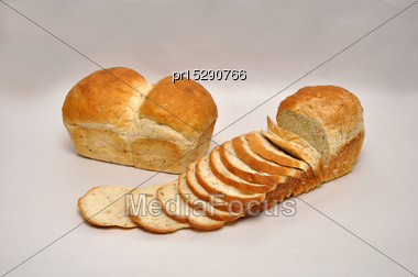 Whole And Sliced Loaves Of Wholemeal Bread On A Seamless Background Stock Photo