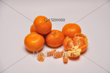 Whole And Sliced Mandarins On A Seamless Background Stock Photo