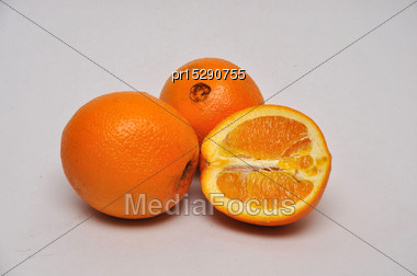Whole And Sliced Navel Oranges On A Seamless Background Stock Photo
