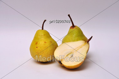 Whole And Sliced Pears On A Seamless Background Stock Photo