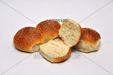 Whole And Sliced Sesame Seed Buns On A Seamless Background Stock Photo