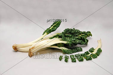 Whole And Sliced Silverbeet On A Seamless Background Stock Photo