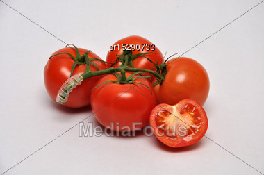 Whole And Sliced Tomatoes On A Seamless Background Stock Photo