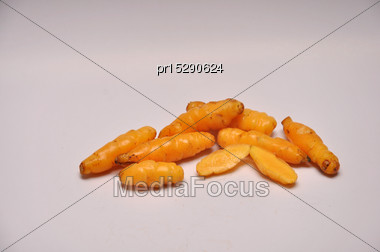 Whole And Sliced Yellow Yams On A Seamless Background Stock Photo