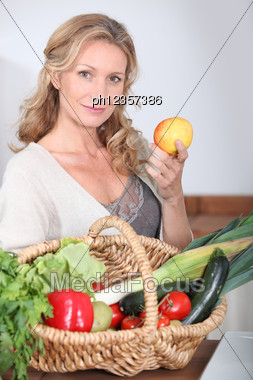 Wife Holding Apple. Stock Photo
