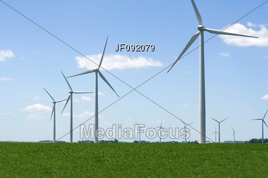 Wind Generators Spinning Away In A Field Stock Photo