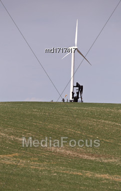 Wind Turbine And Oil Pump In Saskatchewan Canada Stock Photo