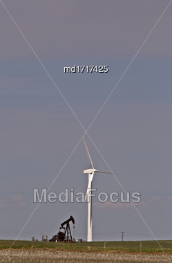 Wind Turbine And Oil Pump In Saskatchewan Canada Stock Photo