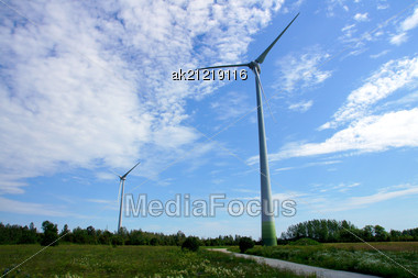 Wind Turbines On A Background Of Blue Sky Stock Photo