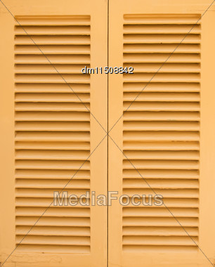 Window With Beige Shutters. Close-up View Stock Photo