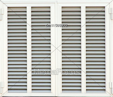 Window With White Shutters. Close-up View Stock Photo
