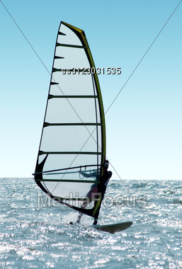 Windsurfer On Waves Of A Sea Stock Photo