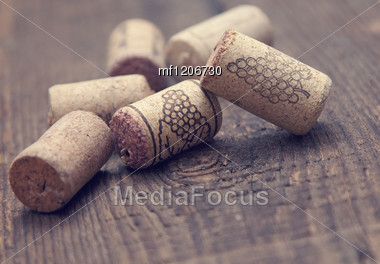 Wine Corks On Wooden Table Stock Photo