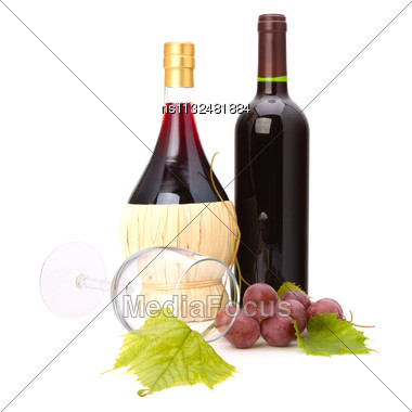 Wine Glass And Two Wine Bottles Isolated On White Background Stock Photo