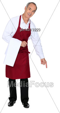 Wine Waiter Pointing Down At Copy Space Stock Photo