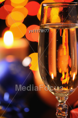 Wineglass With A Champagne On A Background Of Multicoloured Sparks Stock Photo