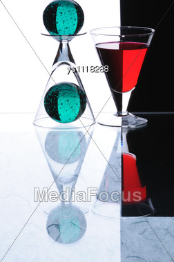Wineglasses And Spheres And Black Background Stock Photo