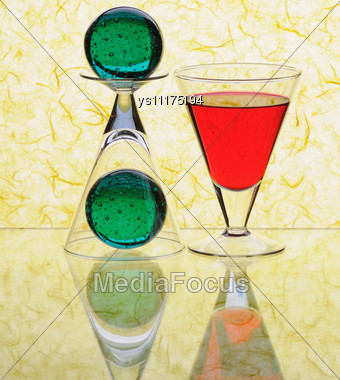 Wineglasses And Spheres On Yellow Background Stock Photo