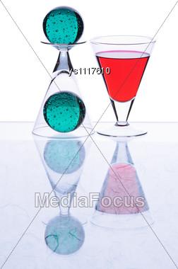 Wineglasses And Spheres Stock Photo
