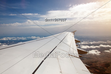 Wing Of An Airplane, View From Window Stock Photo