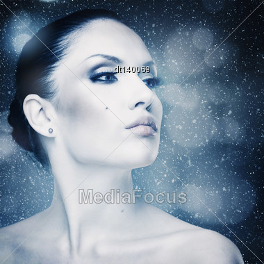 Winter Freshness, Abstract Female Portrait With Falling Snow As Background Stock Photo