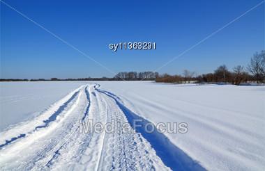 Winter Road On Snow Field Stock Photo
