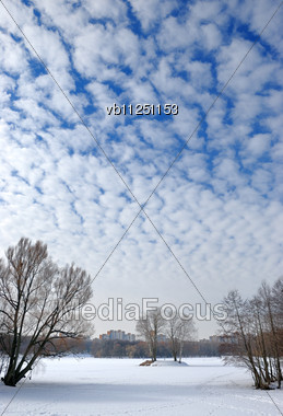 Winter Sky With Small Frequent Clouds Over Lake In A City Stock Photo
