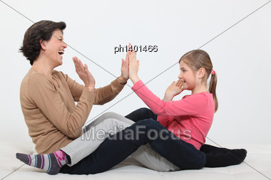 Woman And Girl Clapping Hands Stock Photo