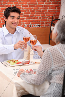 Woman And Grandson At The Restaurant Stock Photo